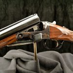 """Parker reproduction shotun, engraved """"Cody Firearms Museum."""""""