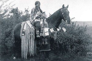 "Cayuse woman rider on horseback. Photograph by E.S. Curtis from ""The North American Indian."" Gift of Douglas L. Manship."