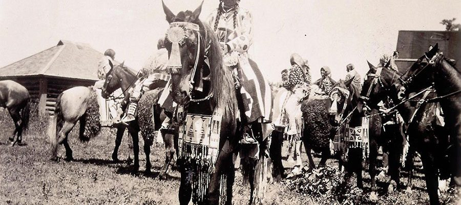 Absaroke (Crow) woman on horse at Crow Fair, Crow Agency, Montana. Photo by W.H.D. Koerner, 1927. P.78.4477