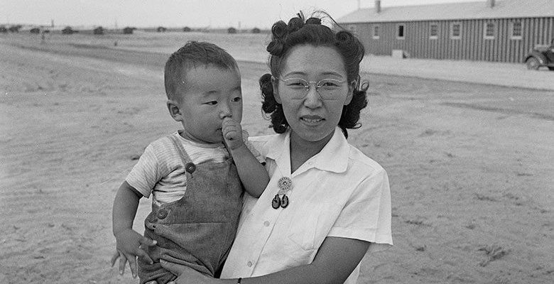 A Treasure from Our West: Jack Richard photograph of mother and son, Heart Mountain Relocation Center. PN.89.111.21237.8