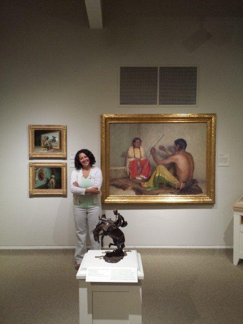 "Whitney Intern Albena Maslinkova by a Joseph Henry Sharp painting, ""The Broken Bow."" 7.75"
