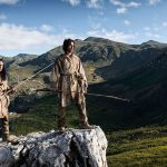"""Scene from """"First Peoples,"""" first Americans survey the landscape."""