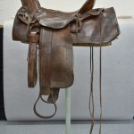 A saddle owned and used by Buffalo Bill in the conservation lab before treatment. Acc# 1.69.875