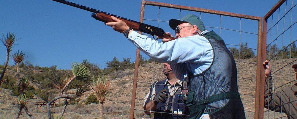 Former U.S. Senator Alan Simpson aims high with his shotgun at a recent Buffalo Bill Shootout.