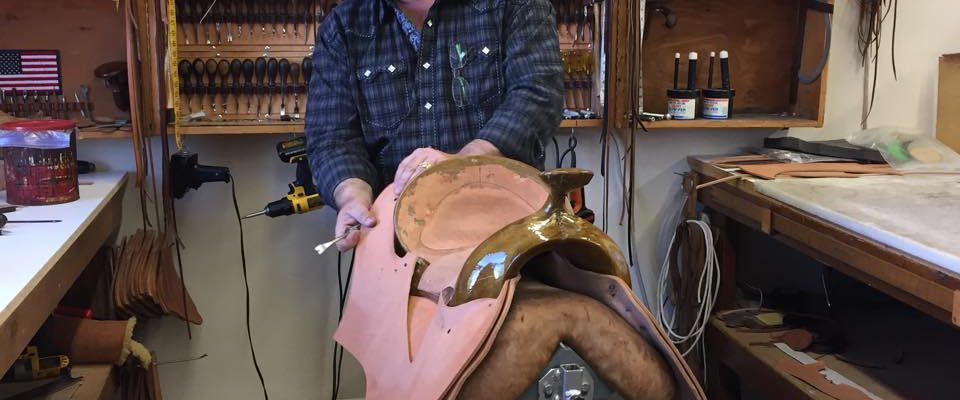 Keith Seidel demonstrating how to put together a saddle.