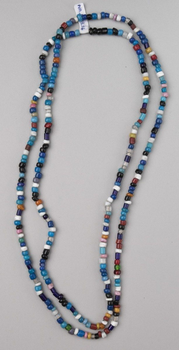Assorted glass trade beads on a necklace. NA.203.36