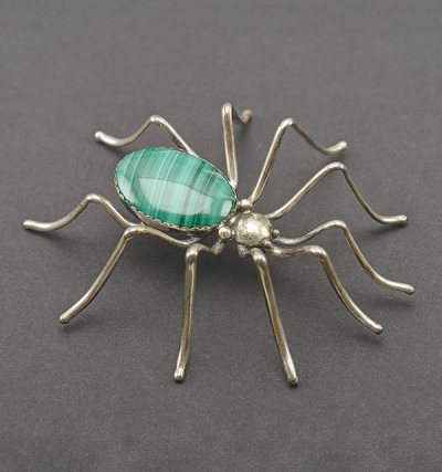 Adornment in the West: Silver and malachite spider pin. On loan from Anne Coe Hayes. L.326.2015.6