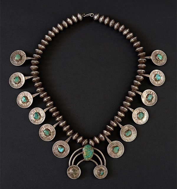 Adornment in the West: Squash blossom necklace made with coins and turquoise. On loan from Naoma Tate. L.402.2015.7