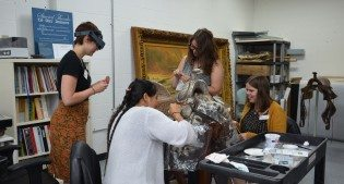 Conservation interns spit cleaning the California Mission saddle.