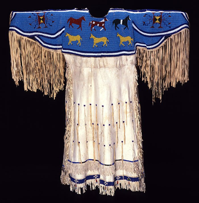 A Sioux dress from around 1900. It's made of deerskin with seed and tin cones for embellishment. NA.202.70