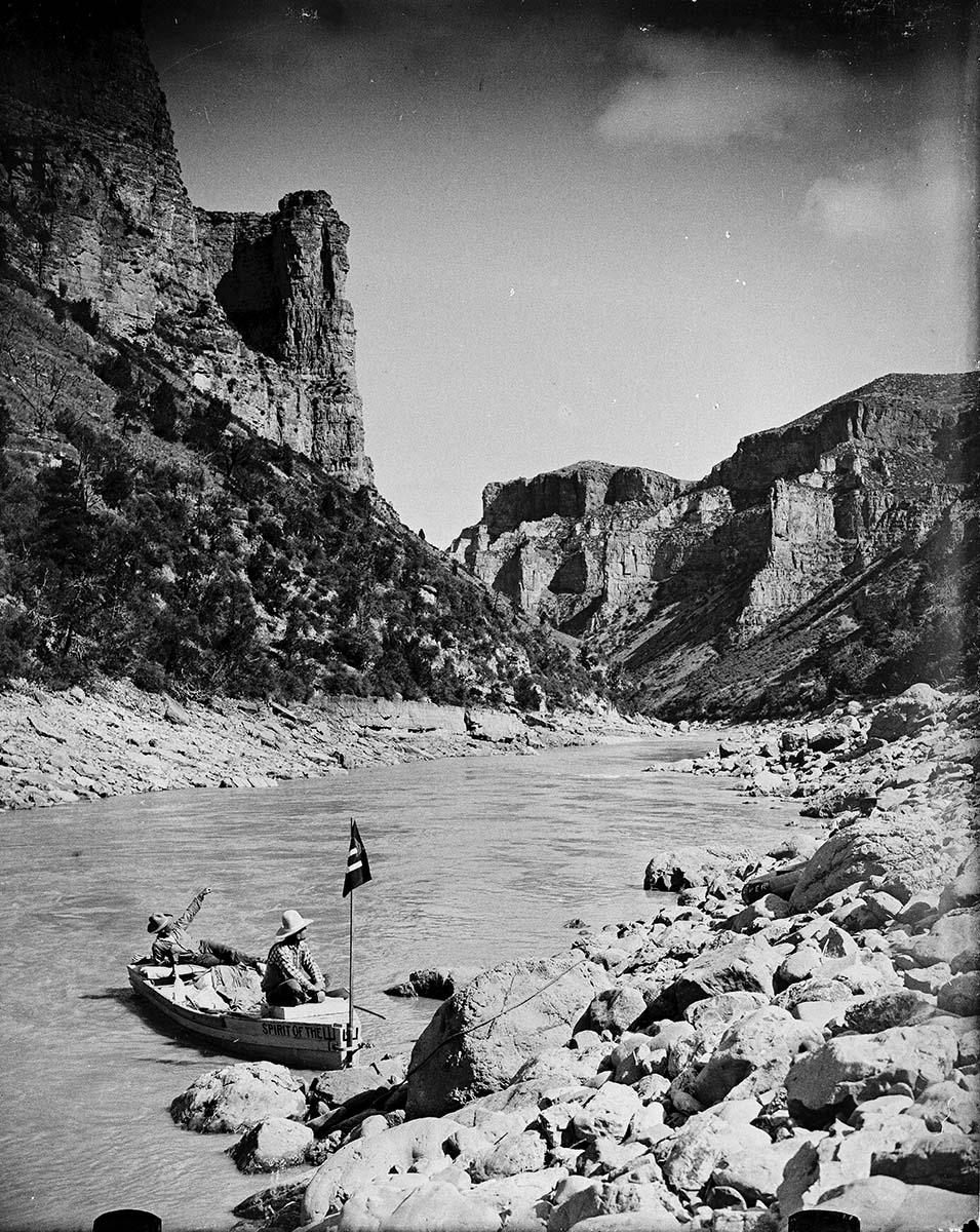 "A Treasure from Our West: Glass plate negative by Charles J. Belden (1887-1966). Alton Wickwire and Carl Dunrud with the boat ""Spirit of the Pitchfork"" on the Big Horn River before it was dammed, August 1928. Charles Belden Collection. PN.67.432b"