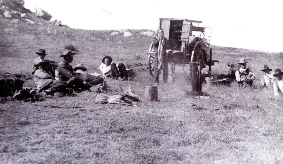 """N.C. Wyeth (1882-1945). """"Mooney-Cook, Jim Peterson. Dale Middlemist (men around chuck-wagon),"""" October 1904. Photograph courtesy Colorado Historical Society. F26,272"""