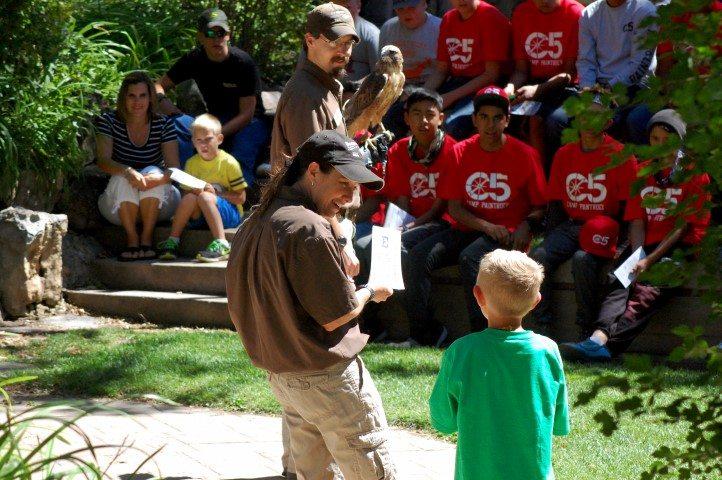 "Carrie preps her volunteer during a ""Superheroes of Nature"" program."