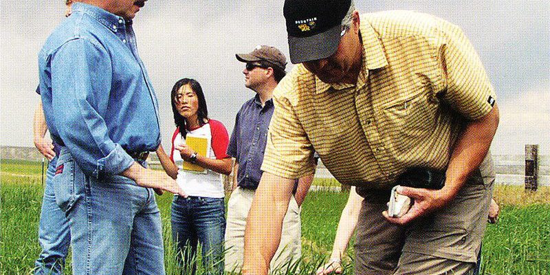 Charles Preston (left), Draper Natural History Museum Curator, leads a filed trip of visiting scholars to explore the grassbanks at the Heart Mountain Ranch near Cody.