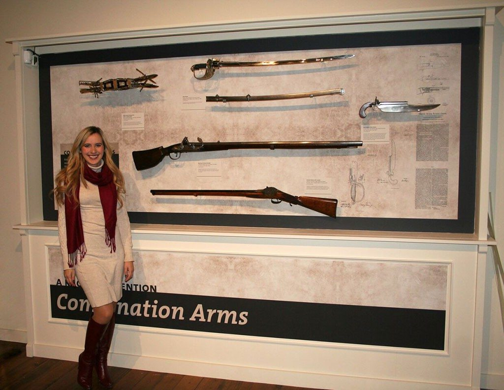 """Cody Firearms Museum Curator Ashley Hlebinsky reviews labels in the Combination Arms section of """"Journeying West: Distinctive Firearms from the Smithsonian"""" at the Buffalo Bill Center of the West."""