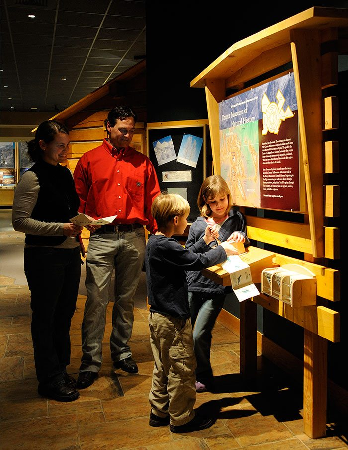 A family gets started with their Adventure Passports in the Draper Natural History Museum.