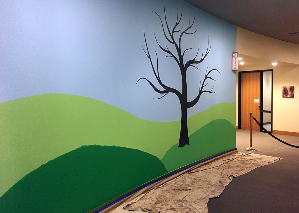 On March 18, Family Fun Day participants will add leaves and other creative touches to this mural begun by artist Sarah Shearer.