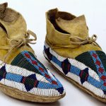Moccasins, ca. 1885. Ute. Rawhide, deerskin, seed beads, pigments. Gift of The Coe Foundation. 1.67.21