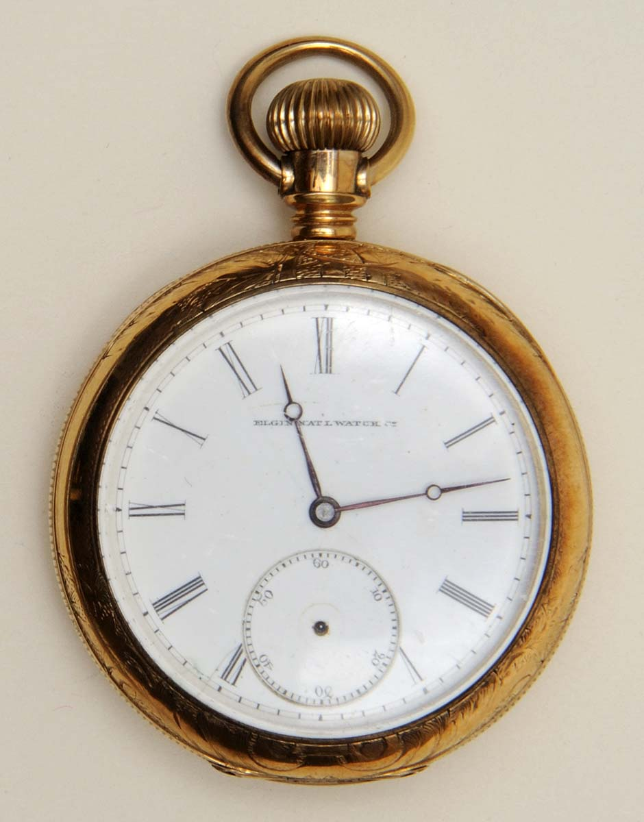 Gold pocket watch, 1885. Elgin National Watch Company, Elgin, Illinois. Gift from the Howard family, in memory of Howell H. Howard. 1.69.6376
