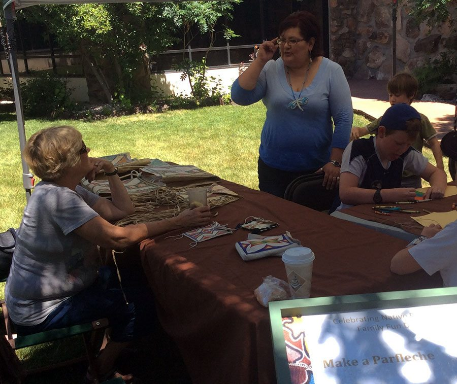 Oglala Lakota artist Jen Runs Close to Lodge (standing), along with Museum Educator Brian Gedron, leads a parfleche-making workshop at the Center of the West June 5 and 6.