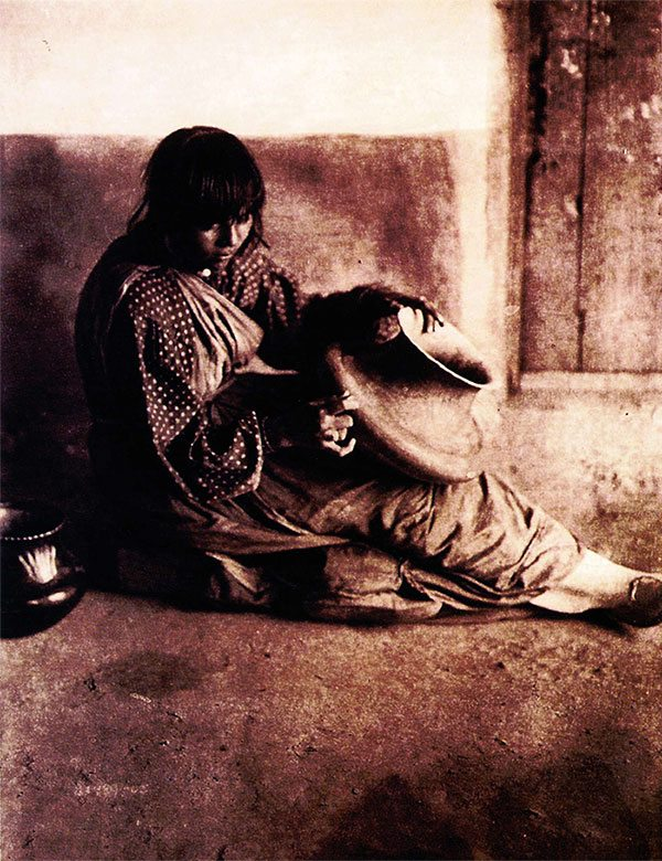 """""""The Potter – Santa Clara"""" 1905, photogravure plate 602 from the 20-volume set of Edward S. Curtis's The North American Indian, Cambridge, Massachusetts: University Press, 1907 – 1930. Curtis is perhaps the most famous photographer of American Indians of the early 20th century."""