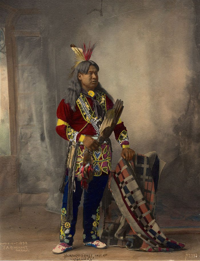 """""""Howard Frost, Omaha's interpreter."""" Frank Rinehart copyrighted this colorized print in 1898 as part of his series of portraits of the Indian Congress of the Trans-Mississippi and International Exposition in Omaha, Nebraska. Adolph F. Muhr took many of the photographs for Rinehart at this exposition. MS 71 Vincent Mercaldo Collection. P.71.633"""