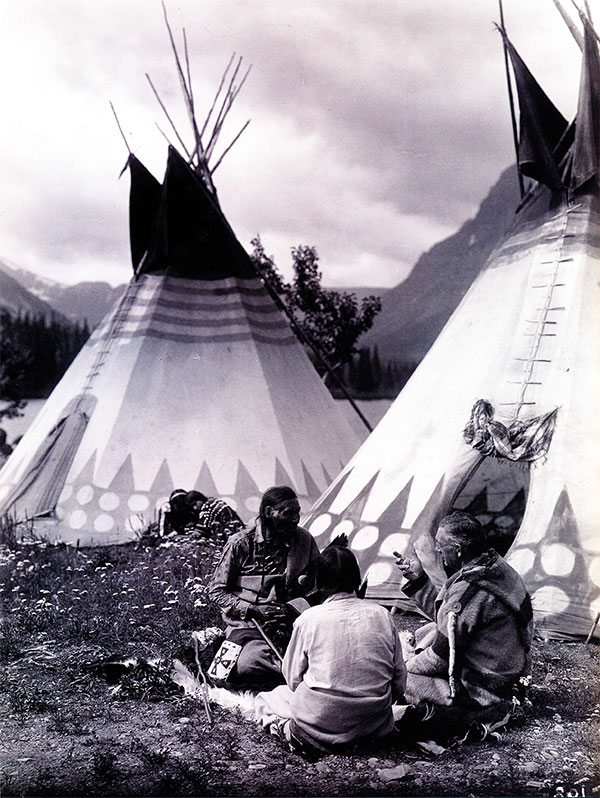 """""""Tail-Feathers-Coming-Over-The-Hill, Yellow Wolf, and James Willard Schultz (Apikuni) at Upper Two Medicine Lake."""" Roland Reed recorded a visit of author J.W. Scott in a Blackfeet camp. MS 43 Roland Reed Collection. P.43.57"""