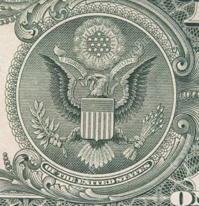 The symbol of a Bald Eagle on the US one dollar bill.