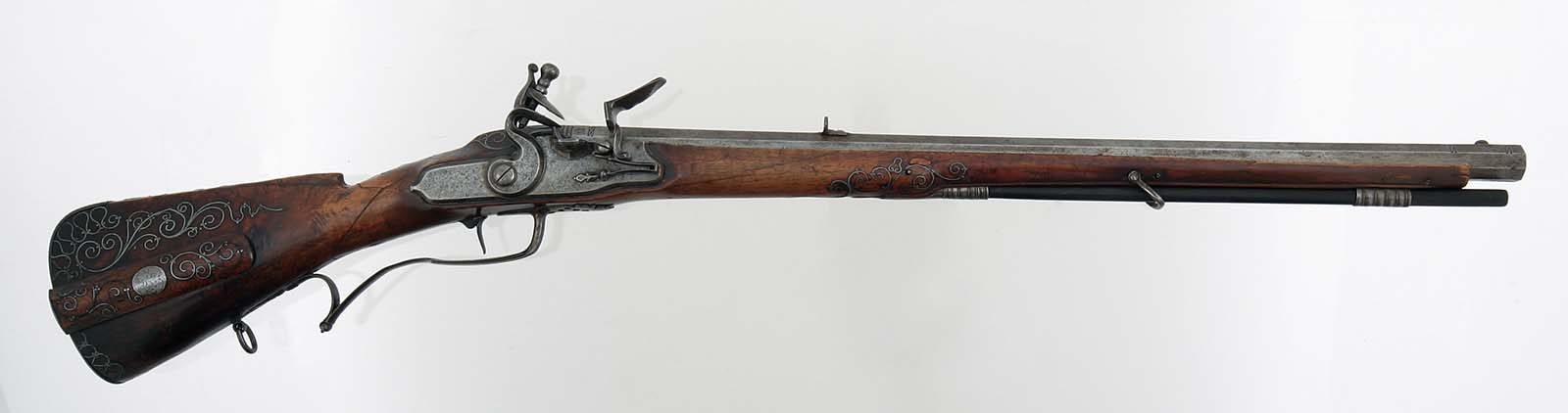 Click the image to view this example of a flintlock system closer. This is a German Flintlock Rifle with an octagon barrel. Gift of Olin Corporation, Winchester Arms Collection. 1988.8.391