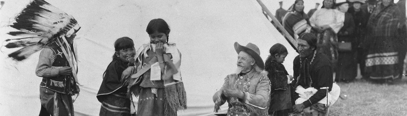 Buffalo Bill takes time to play with young American Indian children whose parents were more than likely actors in his Wild West, ca. 1913. MS 6 William F. Cody Collection. P.6.243