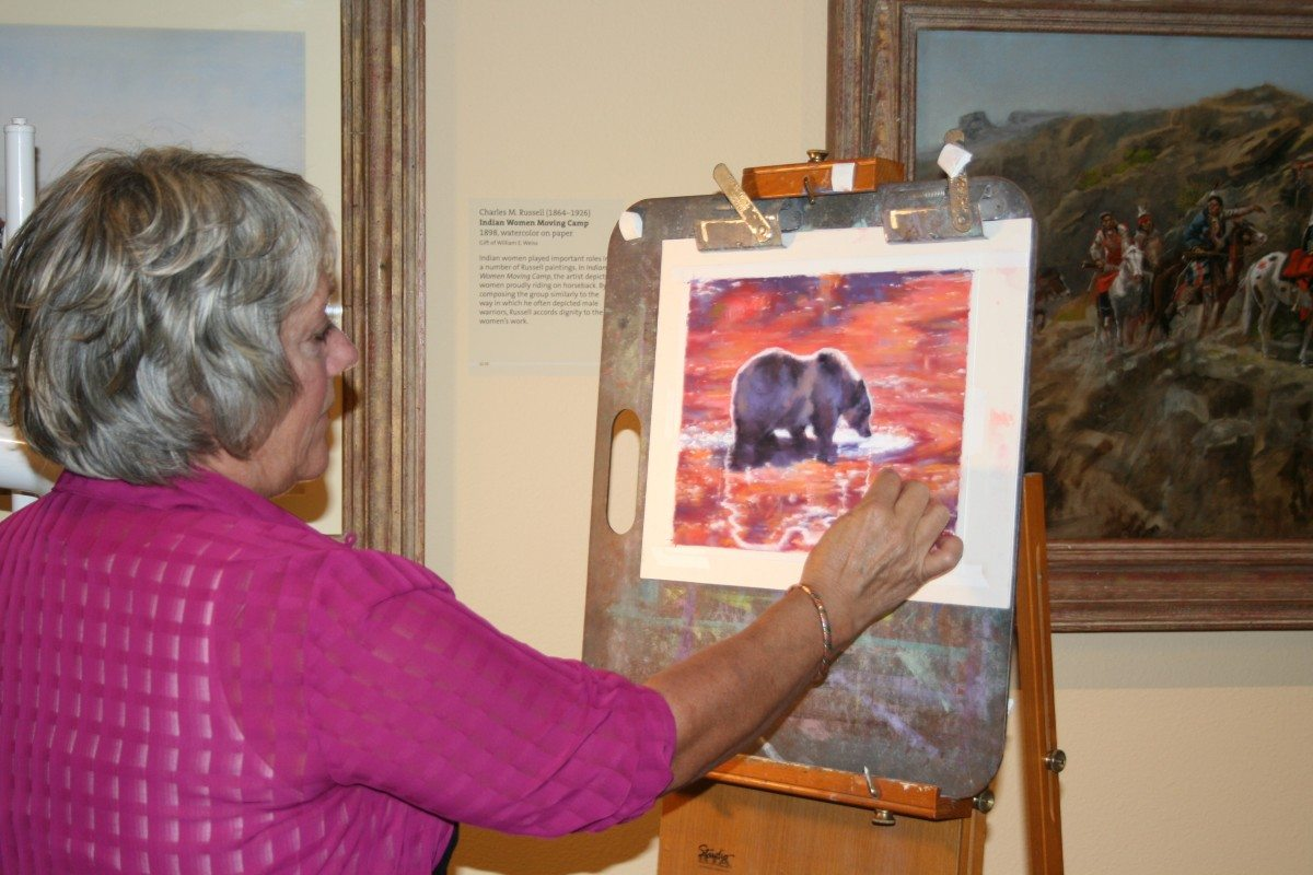 Surrounded by inspiration, Julie Oriet creates an original pastel at the Center during her residency.