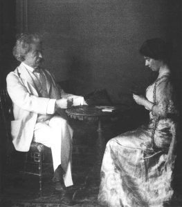 Twain playing cards with daughter Clara, ca. 1908. Photo courtesy The Mark Twain Archive, Elmira College, Elmira, New York.