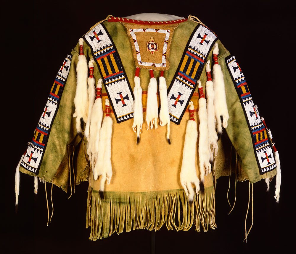 Man's Shirt. Austin Box, Southern Ute, Security, Colorado, 1989. Tanned deer hide, pre-1880 glass beads, seam binding, ermine, dyed porcupine quills, commercial dyes, nylon thread. Gift of Mr. & Mrs. William D. Weiss. NA.202.1007