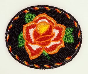 Beaded belt buckle, Becky Harris O'Brien. Eastern Shoshone, Kinnear, Wyoming. Glass beads, tanned hide, brass, 2003. Plains Indian Museum Acquisitions Fund Purchase. NA.203.1279