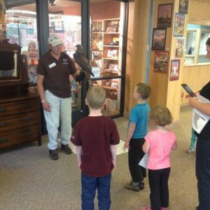Sally and Isham teaching visitors about red-tailed hawks.