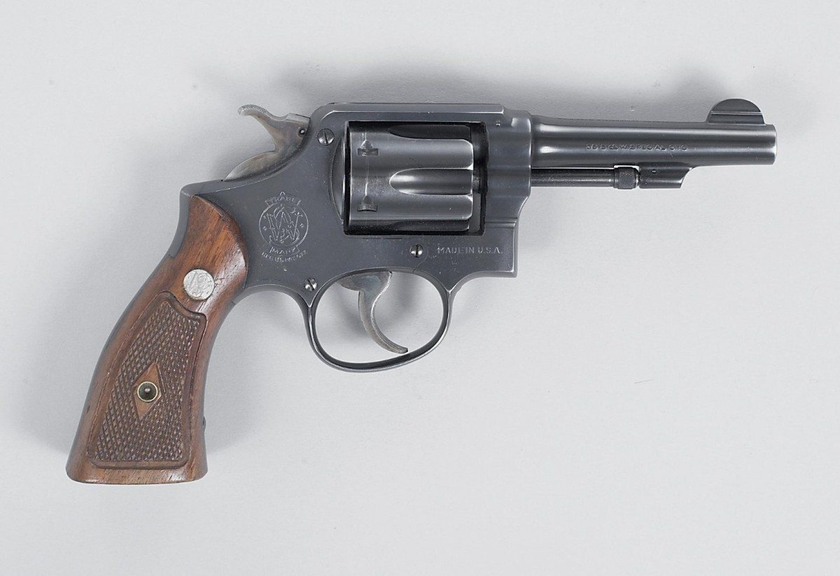 Prior to the widespread switch to semi-autos, many police departments carried .38 revolvers, much like this S&W. Gift of Janet Jerome and daughters in memory of John K. Jerome. 1999.17.199