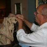 Jeff Rudolph sculpting with clay.