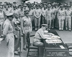 Famous photograph of Admiral Nimitz accepting Japan's surrender to end World War II; this image was autographed by the Admiral for Jack Richard.