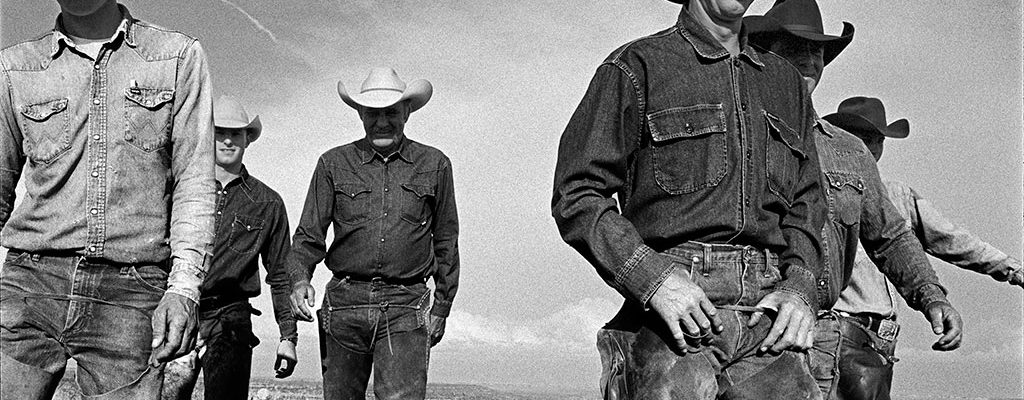 Laura Wilson. Cowboys Walking, J.R. Green Cattle Company Shackelford County, Texas, May 13, 1997. Gelatin silver print, 44 x 66 in. Private Collection.
