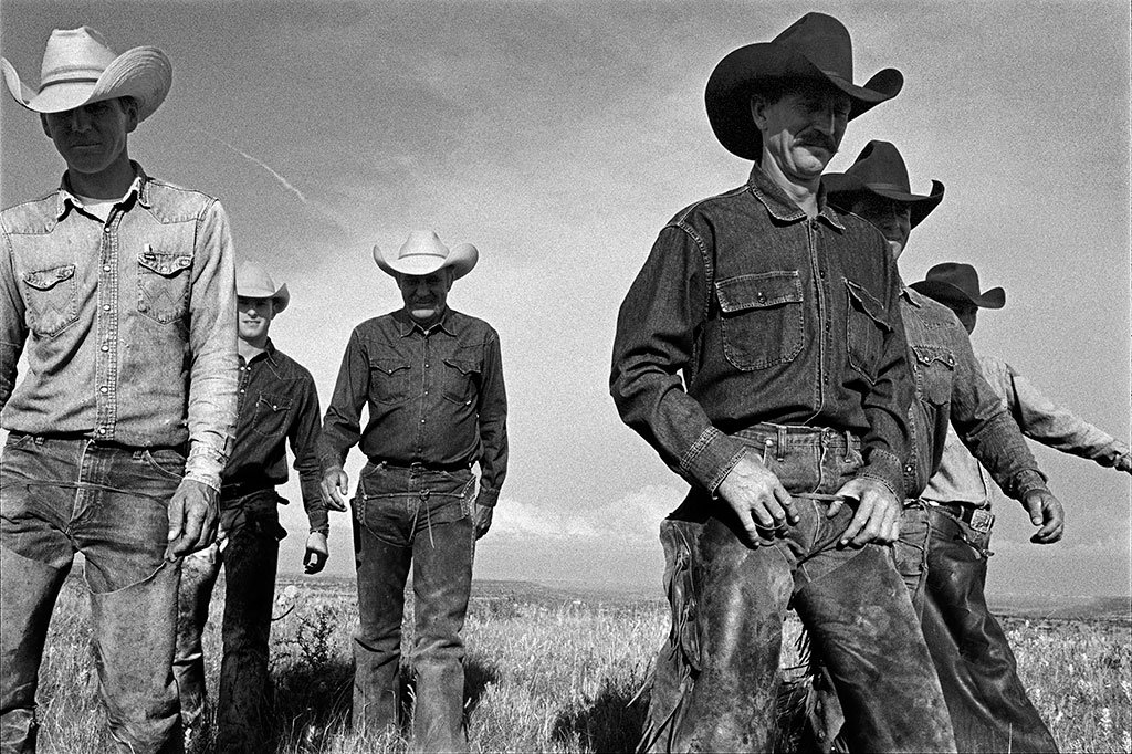 "Laura Wilson. Cowboys Walking, J.R. Green Cattle Company Shackelford County, Texas, May 13, 1997. Gelatin silver print, 44 x 66 in. Private Collection. From ""That Day"" photography exhibition."