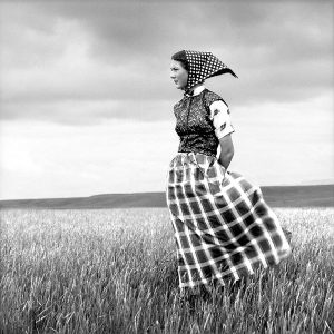 Laura Wilson. Emma, Hutterite Girl in Field, Duncan Ranch Colony Harlowton, Montana, June 17, 1994. Archival pigment print, 46 x 46 in. Private Collection.