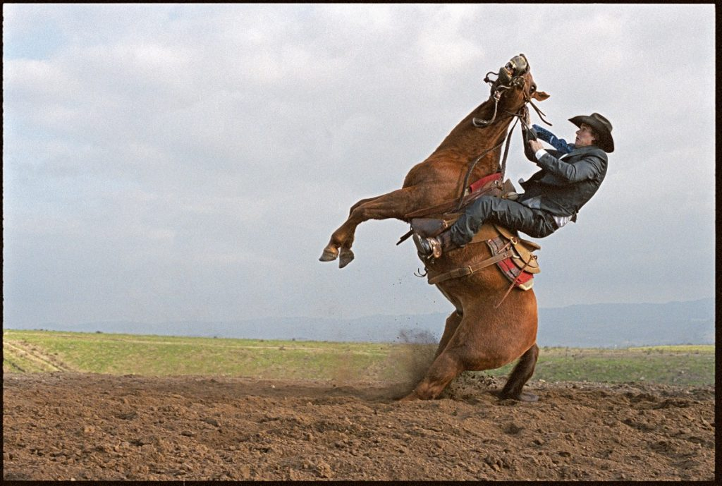Laura Wilson. Stunt Cowboy Falling Off Horse, Ventura County, California, February 20, 2007.
