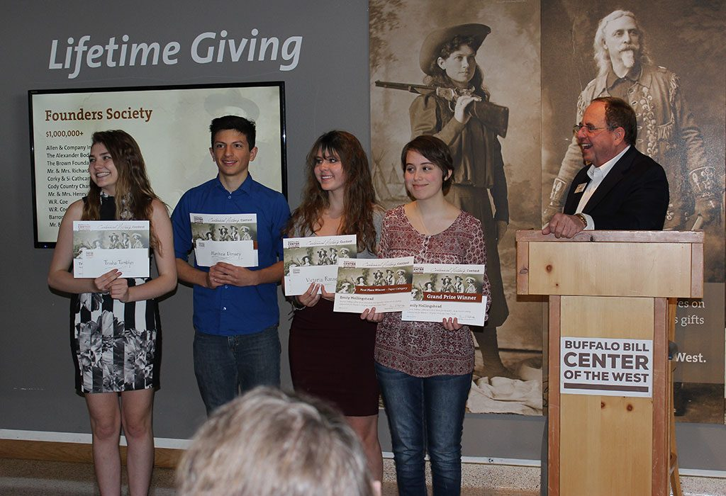 Winners of our Centennial History Contest receive their awards from Center of the West Executive Director Bruce Eldredge.