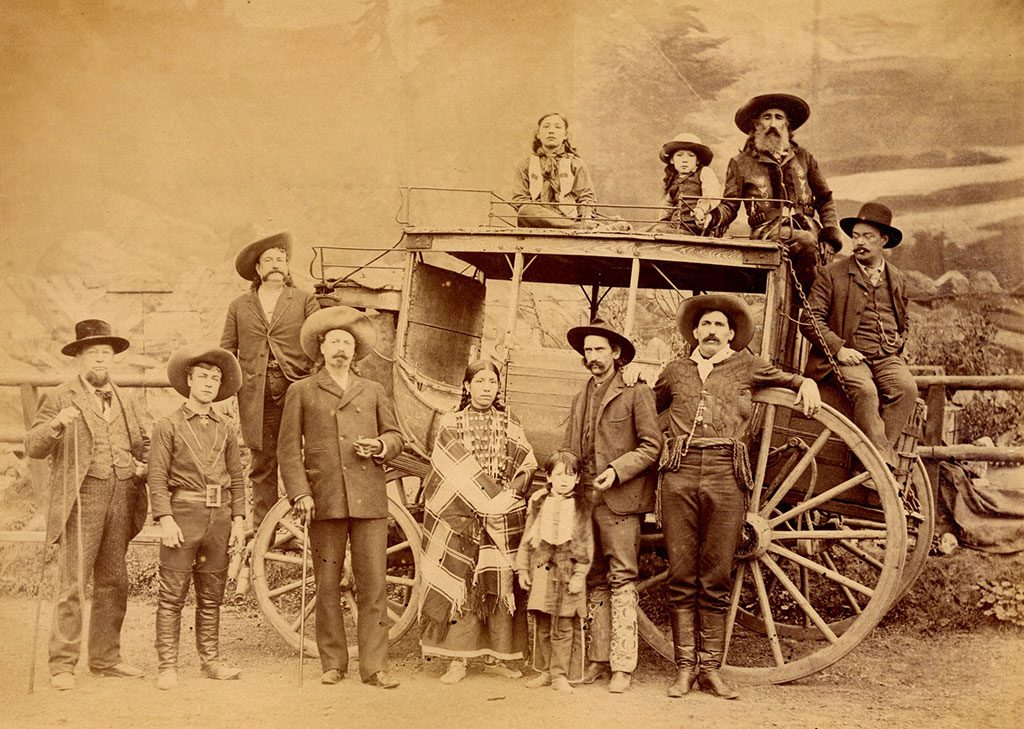 Pictured with the Deadwood Stage are: W.F. Cody (in front of left front wheel), Johnny Baker to Cody's right, Major Burke (standing behind on the coach's tongue), and others from Buffalo Bill's Wild West. MS 6 William F. Cody Collection, McCracken Research Library. P.69.2041.1
