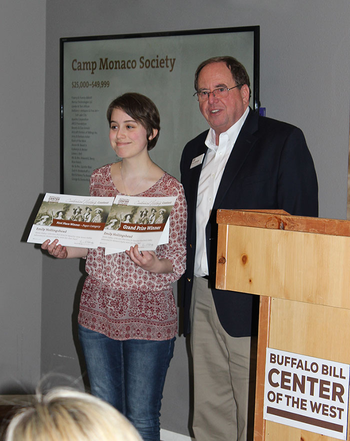 Emily receives her awards from Center Executive Director Bruce Eldredge.