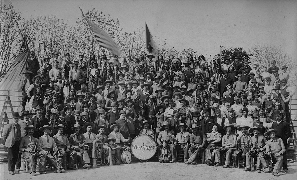 Cast of Buffalo Bill's Wild West in Milan, 1908. Annie Oakley is standing behind and to the left of the bass drum, with rifle over her shoulder. MS6 William F. Cody Collection. P.69.817