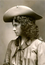 Portrait of Annie Oakley wearing a light hat with a star on brim, kerchief, and blouse, ca. 1902, P.69.1161