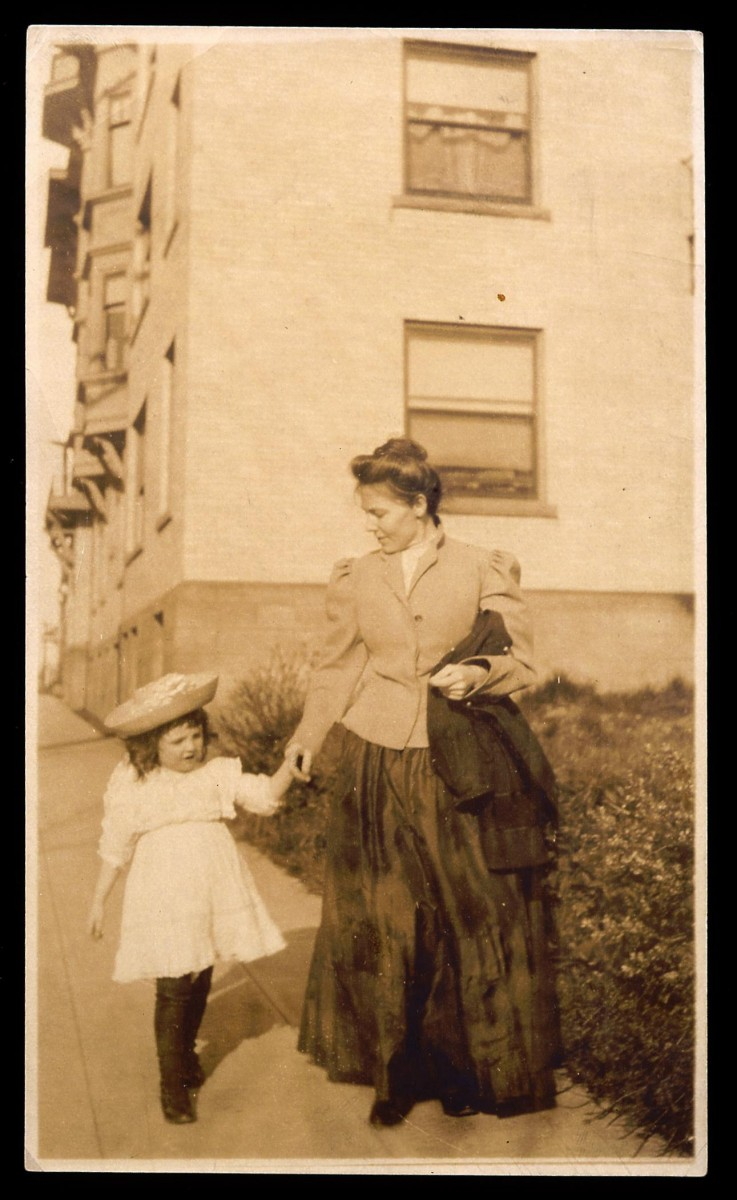 The first and second curators of the Buffalo Bill Museum, Mary Jester Allen leads her daughter Helen down a street in Seattle in 1909. MS 41 Mary Jester Allen, Original Buffalo Bill Collection, McCracken Research Library. P.41.1