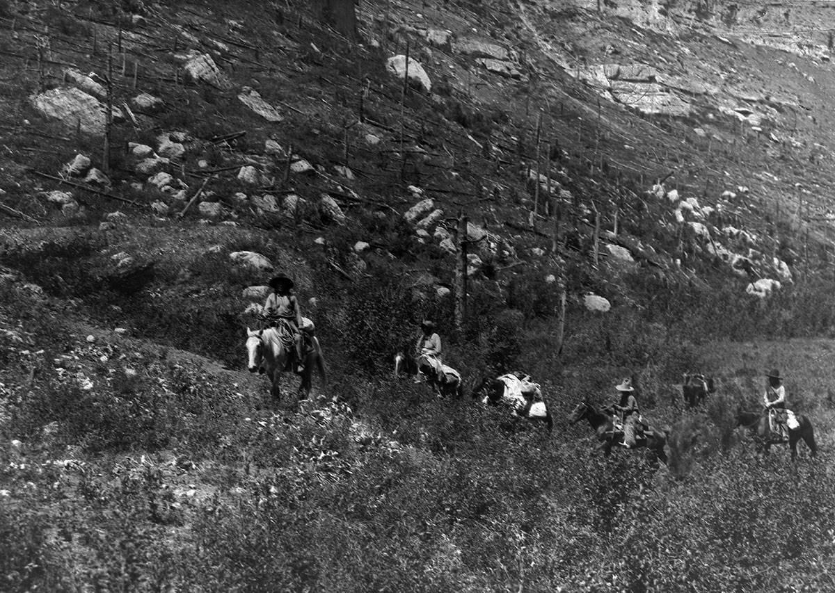 Crow people on horses in canyon, ca. 1903-1925. MS 95 William A. Petzoldt Lantern Slide Collection. LS.95.197