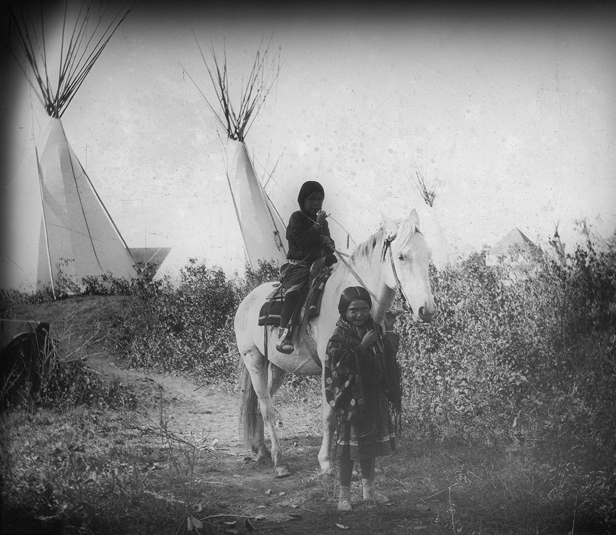 Crow children on horseback, ca. 1903–1925. MS 95 William A. Petzoldt Lantern Slide Collection. LS.95.385